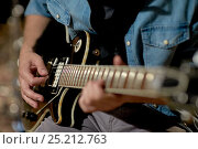 Купить «close up of man playing guitar at studio rehearsal», фото № 25212763, снято 18 августа 2016 г. (c) Syda Productions / Фотобанк Лори