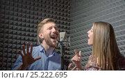 Купить «Singers in a recording studio», видеоролик № 25222695, снято 23 октября 2018 г. (c) Raev Denis / Фотобанк Лори