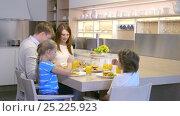 Купить «Parents and children at home», видеоролик № 25225923, снято 19 сентября 2019 г. (c) Raev Denis / Фотобанк Лори
