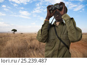 Купить «Member of the Rhino patrol, partly funded by Save the Rhino international, looks out using binoculars, Lewa Conservancy, Laikipia, Kenya, September 2012», фото № 25239487, снято 26 сентября 2018 г. (c) Nature Picture Library / Фотобанк Лори