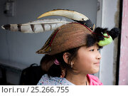 Купить «Girl wearing a hat with a hornbill lower mandibel, a raptor feather and civet fur, Tawang, Arunachal Pradesh, India 2008», фото № 25266755, снято 24 сентября 2018 г. (c) Nature Picture Library / Фотобанк Лори