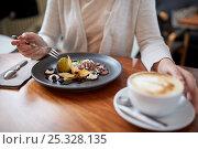 Купить «woman eating ice cream dessert with coffee at cafe», фото № 25328135, снято 16 января 2017 г. (c) Syda Productions / Фотобанк Лори