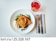 Купить «fish salad and glass of drink on restaurant table», фото № 25328167, снято 16 января 2017 г. (c) Syda Productions / Фотобанк Лори
