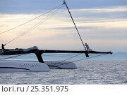 """Купить «Crew on bowsprit of 90ft catamaran """"Alinghi 5"""" training prior to the first race of the 33rd America's Cup, Valencia, Spain. February 2010. ^^^A Deed of...», фото № 25351975, снято 19 июня 2018 г. (c) Nature Picture Library / Фотобанк Лори"""