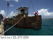 Купить «Tugboat wreck ''Blue Plunder'' being prepared for towing out to sea and sinking. Nassau, Bahamas. August 2007.», фото № 25377059, снято 21 сентября 2018 г. (c) Nature Picture Library / Фотобанк Лори