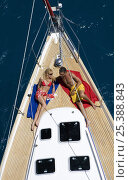 Купить «Couple relaxing on bow of yacht in the British Virgin Islands, Caribbean. Model released, March 2006.», фото № 25388843, снято 22 июля 2018 г. (c) Nature Picture Library / Фотобанк Лори