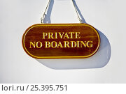 """Купить «""""Private: No Boarding"""" sign on a motor yacht.», фото № 25395751, снято 19 января 2020 г. (c) Nature Picture Library / Фотобанк Лори"""