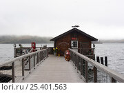 """Купить «""""Boat Shack"""" at the end of the dock at Tomales Bay on a grey summers day.», фото № 25401563, снято 15 ноября 2018 г. (c) Nature Picture Library / Фотобанк Лори"""