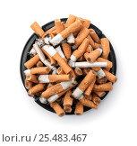 Купить «Ashtray full of cigarette butts. Top view.», фото № 25483467, снято 5 мая 2016 г. (c) Антон Стариков / Фотобанк Лори