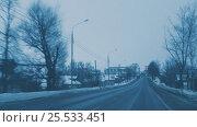 Driving on evening winter road. View through drivers windshield. (2017 год). Редакционное видео, видеограф Chudakov_Ivan / Фотобанк Лори