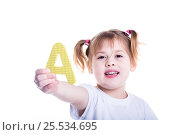 5 years old Girl with a yellow letter a on a white background. Стоковое фото, фотограф Mariya Eremenko / Фотобанк Лори