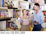 Купить «Portrait of adult couple choosing erotic toys», фото № 25551359, снято 23 марта 2019 г. (c) Яков Филимонов / Фотобанк Лори