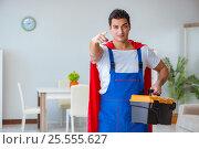 Купить «Super hero repairman working at home», фото № 25555627, снято 23 декабря 2016 г. (c) Elnur / Фотобанк Лори