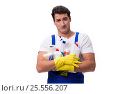 Купить «Man with cleaning agents isolated on white background», фото № 25556207, снято 31 октября 2016 г. (c) Elnur / Фотобанк Лори