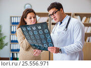 Купить «Young doctor looking at computer tomography x-ray image», фото № 25556971, снято 8 декабря 2016 г. (c) Elnur / Фотобанк Лори
