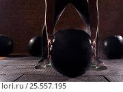 Купить «Female athlete doing workout with heavy ball», фото № 25557195, снято 11 сентября 2016 г. (c) Pavel Biryukov / Фотобанк Лори