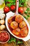 Фрикадельки в томатном соусе в форме для запекания на обеденном столе. Вид сверху, фото № 25567991, снято 14 февраля 2017 г. (c) Надежда Мишкова / Фотобанк Лори