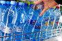 Мужская рука достаёт из холодильника бутылку Aqua Minerale, фото № 25569563, снято 12 февраля 2017 г. (c) Александр Тарасенков / Фотобанк Лори