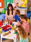 Children painting and drawing together . Craft lesson in primary school., фото № 25569703, снято 4 октября 2015 г. (c) Gennadiy Poznyakov / Фотобанк Лори