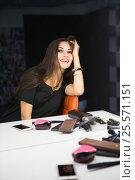 Купить «Cheerful young brunette», фото № 25571151, снято 30 августа 2015 г. (c) Сергей Сухоруков / Фотобанк Лори