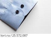 Купить «close up of blue shirt sleeve», фото № 25572087, снято 15 сентября 2016 г. (c) Syda Productions / Фотобанк Лори