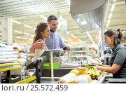 Купить «couple buying food at grocery store cash register», фото № 25572459, снято 21 октября 2016 г. (c) Syda Productions / Фотобанк Лори