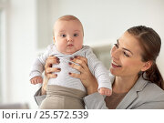 Купить «happy businesswoman with baby at office», фото № 25572539, снято 9 декабря 2016 г. (c) Syda Productions / Фотобанк Лори