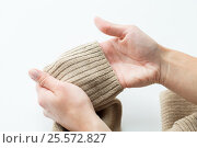 Купить «close up of hands with sweater sleeve», фото № 25572827, снято 15 сентября 2016 г. (c) Syda Productions / Фотобанк Лори