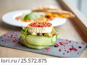 Купить «goat cheese salad with vegetables at restaurant», фото № 25572875, снято 22 сентября 2016 г. (c) Syda Productions / Фотобанк Лори