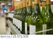 Купить «close up of bottles at liquor store», фото № 25572935, снято 2 ноября 2016 г. (c) Syda Productions / Фотобанк Лори