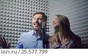 Купить «Young singers in recording studio», видеоролик № 25577799, снято 23 октября 2018 г. (c) Raev Denis / Фотобанк Лори