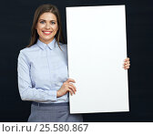 Купить «Happy emotional business woman holding white sign board studio portrait», фото № 25580867, снято 14 сентября 2016 г. (c) sheftsoff / Фотобанк Лори
