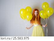 Купить «Young woman with balloons», фото № 25583975, снято 16 февраля 2017 г. (c) Типляшина Евгения / Фотобанк Лори
