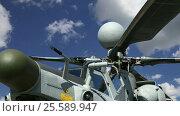 Купить «Details of the rotor and part of the body of modern military helicopters closeup», видеоролик № 25589947, снято 19 февраля 2017 г. (c) Владимир Журавлев / Фотобанк Лори