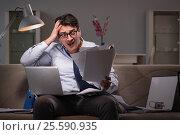 Купить «Businessman workaholic working late at home», фото № 25590935, снято 12 января 2017 г. (c) Elnur / Фотобанк Лори