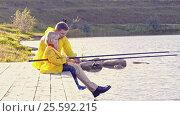 Купить «Father and son fishing on lake», видеоролик № 25592215, снято 23 ноября 2019 г. (c) Raev Denis / Фотобанк Лори