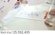 Купить «Business people discussing charts», видеоролик № 25592435, снято 21 февраля 2017 г. (c) Иван Михайлов / Фотобанк Лори