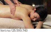 Купить «woman lying and having back massage at spa», видеоролик № 25593743, снято 28 января 2017 г. (c) Syda Productions / Фотобанк Лори