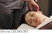 Купить «woman having head massage at spa», видеоролик № 25593767, снято 28 января 2017 г. (c) Syda Productions / Фотобанк Лори