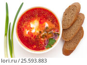 Russian, Ukrainian and Polish national soup - borscht soup made of beetrot, vegetables and meat at white background. Стоковое фото, фотограф Евгений Пидеркин / Фотобанк Лори