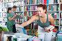 girl teenager choosing book in shop, фото № 25596827, снято 16 сентября 2016 г. (c) Яков Филимонов / Фотобанк Лори