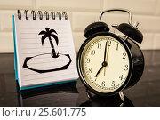 Купить «Будильник и рисунок южного острова на листе блокнота», фото № 25601775, снято 23 февраля 2017 г. (c) Сергеев Валерий / Фотобанк Лори