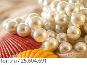 Купить «White pearl and seashells on sand», фото № 25604691, снято 4 марта 2016 г. (c) Ярочкин Сергей / Фотобанк Лори