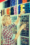 Mature glad woman customer picking various yarn, фото № 25609435, снято 25 февраля 2017 г. (c) Яков Филимонов / Фотобанк Лори