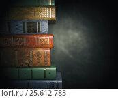 Vintage books on old black dirty background. Стоковое фото, фотограф Maksym Yemelyanov / Фотобанк Лори