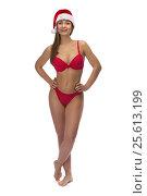 Купить «Girl in red underwear and a Santa hat», фото № 25613199, снято 18 декабря 2016 г. (c) Руслан Кудрин / Фотобанк Лори