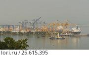 Купить «Cargo port in the work. Ha Long Bay. Vietnam.», видеоролик № 25615395, снято 20 февраля 2017 г. (c) Mikhail Davidovich / Фотобанк Лори