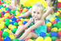 portrait of girl playing in pool with plastic multicolored ball, фото № 25617955, снято 27 февраля 2017 г. (c) Яков Филимонов / Фотобанк Лори