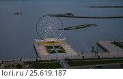 Купить «Night view of the city Baku and Ferris wheel», видеоролик № 25619187, снято 25 февраля 2017 г. (c) Elena Odareeva / Фотобанк Лори