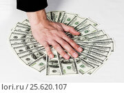 Money fanned out on the table and hand. Стоковое фото, фотограф Alexey Matushkov / Фотобанк Лори